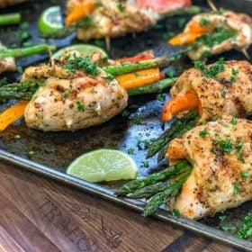 Chicken veggie roll ups on a pan