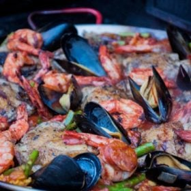 Grilled paella in a pan