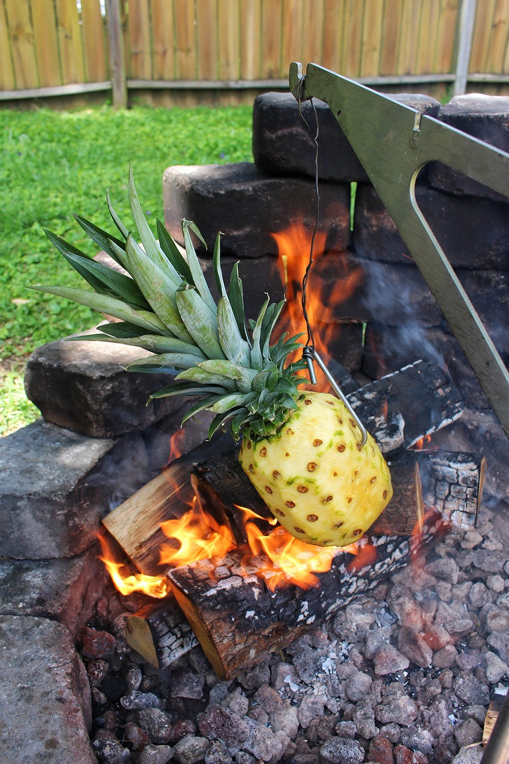 Pineapple roasting over an open fire