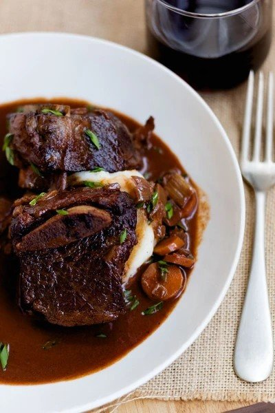 Raspberry chipotle braised short ribs on a plate