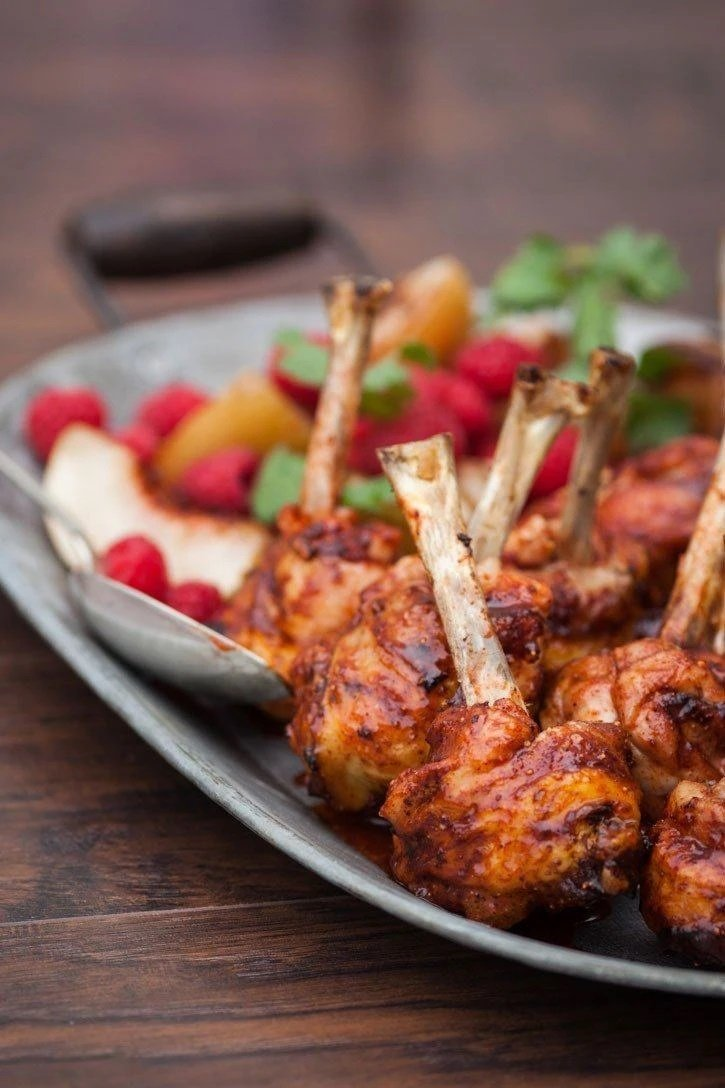 Raspberry Chipotle Chicken Lollipops on a dish