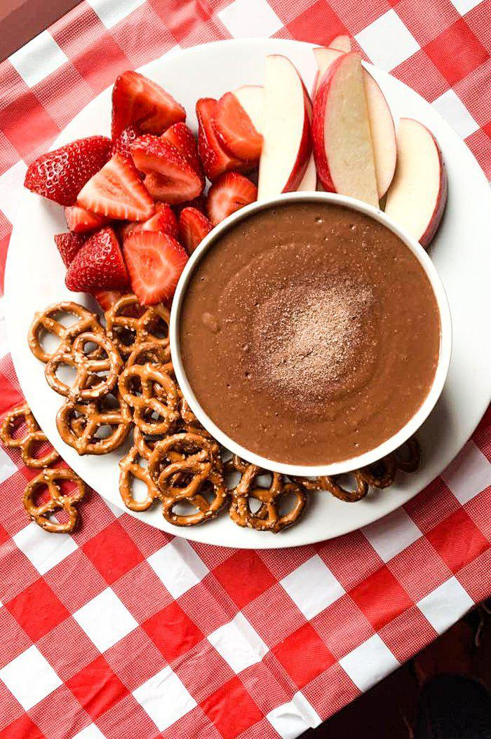 S'mores hummus with strawberries, apples, and pretzels