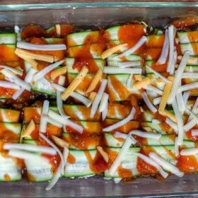 Cajun Zucchini enchiladas in a pan before cooking