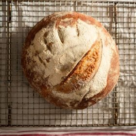 Sourdough bread cooling on a rack