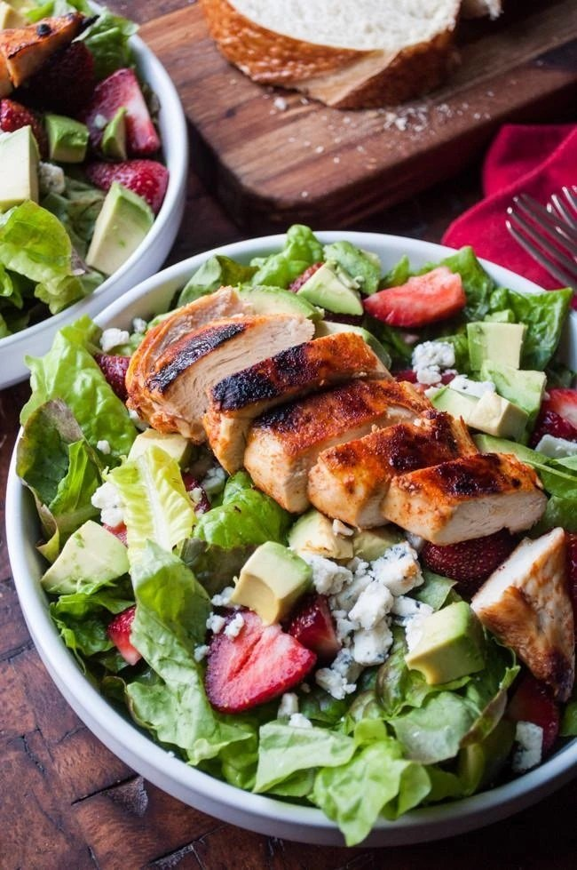Spicy Chicken strawberry salad in a bowl
