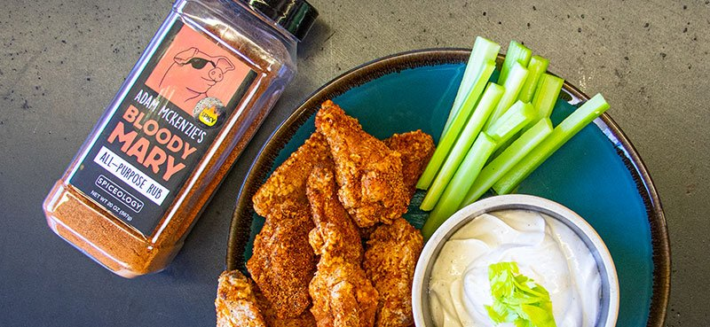 Spicy Bloody Mary wings with celery sticks and dip