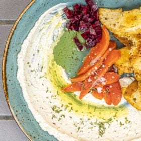 Labneh in a bowl with cured salmon and bagel chips