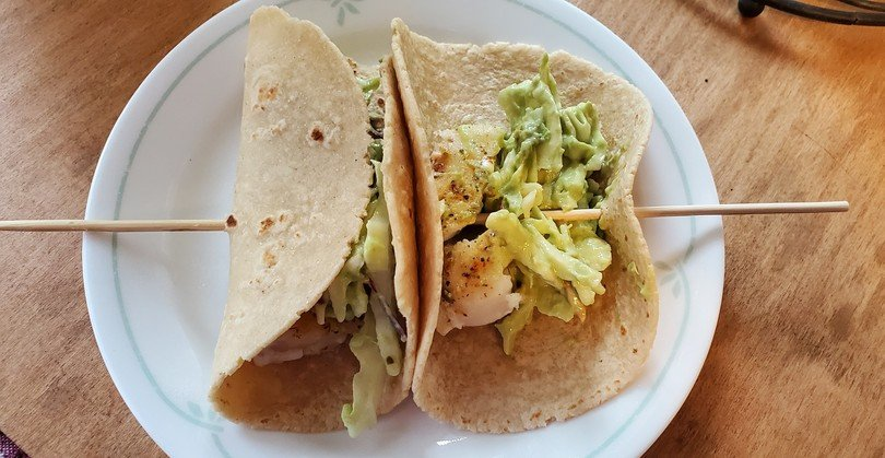 Guac and Roll Fish Tacos with Avocado Slaw