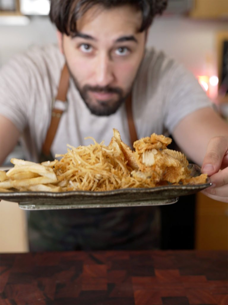 Matt Broussard holds a plate of french fries