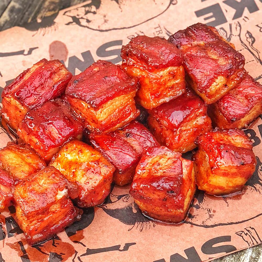 Pork Belly Burnt ends on peach paper
