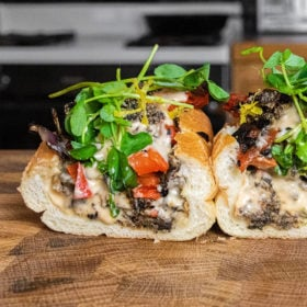 Mushroom Philly sandwich sliced in half