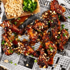 a sheet pan of chicken drumettes with a korean bbq sauce