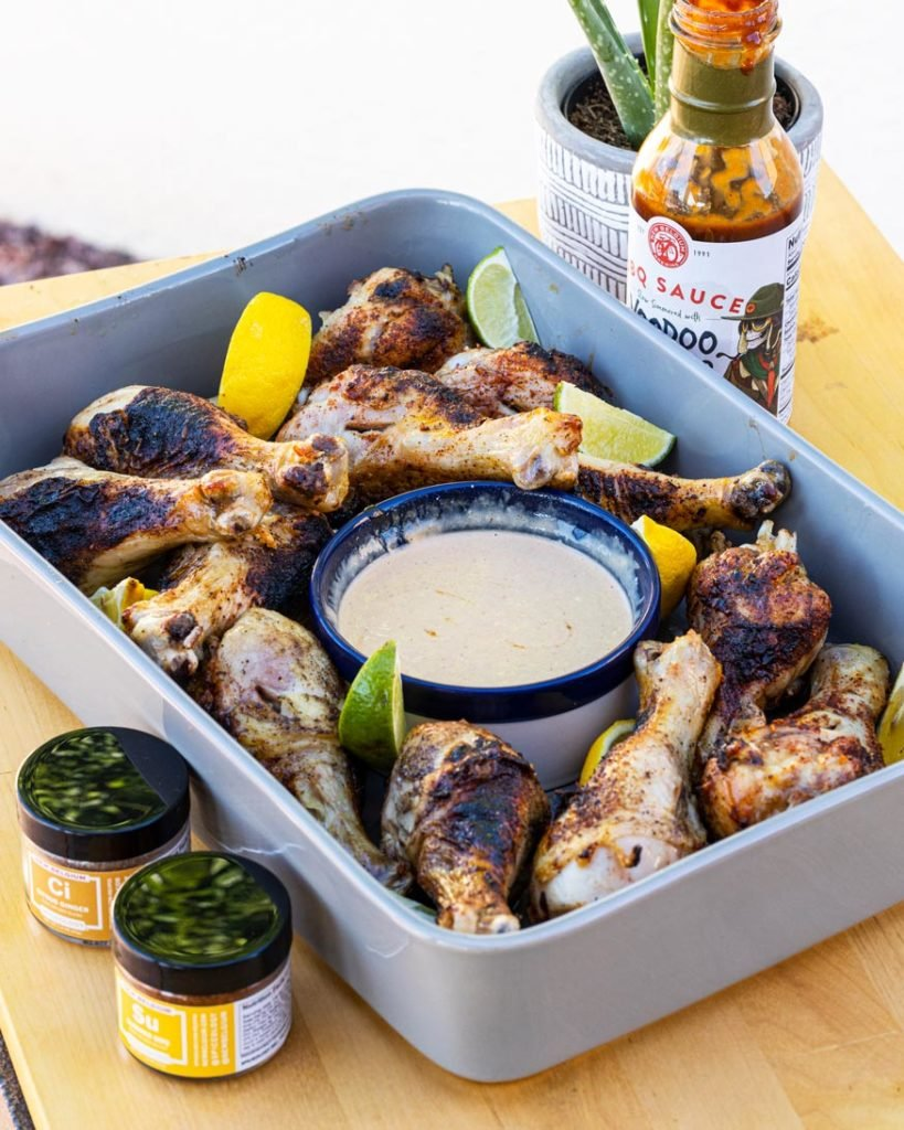 New Belgium rilled chicken skewers in tray with creamy bbq dipping sauce