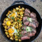 bourbon prime steak and eggs in a cast iron pan