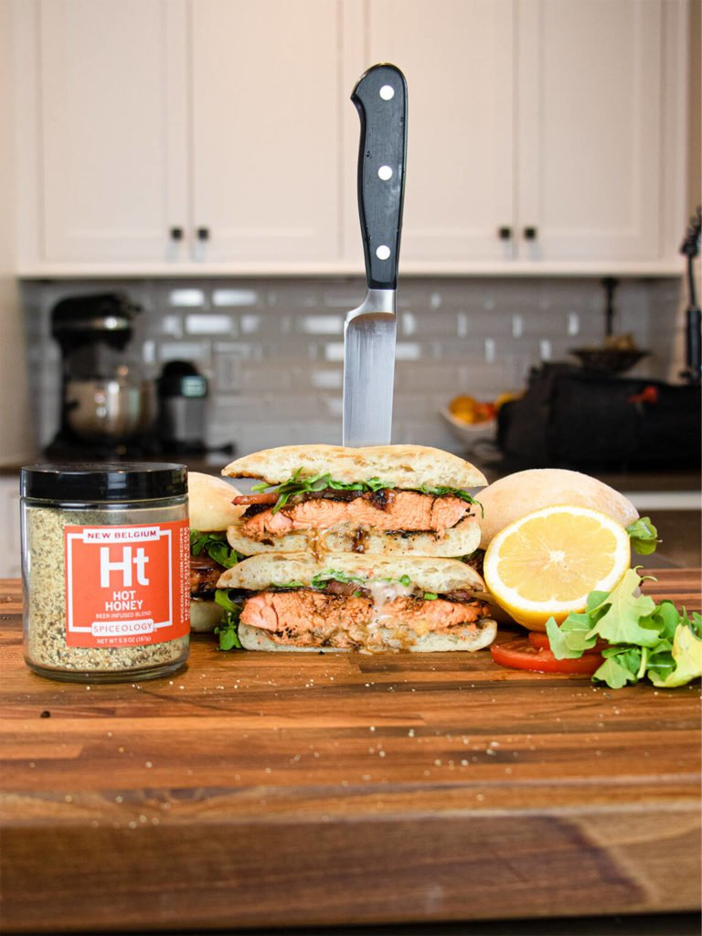 Hot Honey Salmon Sandwich on cutting board sliced and stacked
