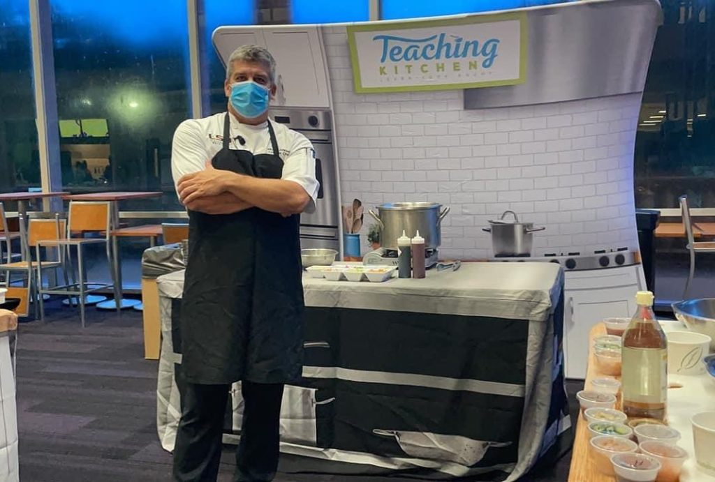 Michael Johnson teaching in kitchen