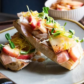 Bourbon prime marinated peach toast stacked on plate